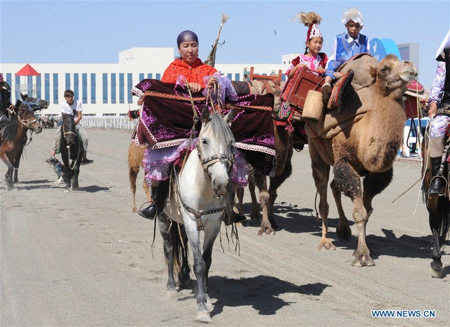 Horses and camels perform during the opening ceremony of a folk custom tourism festival held in the Kazak Autonomous County of Mori in northwest China\'s Xinjiang Uygur Autonomous Region, Aug. 11, 2018. The two-day festival opened here on Saturday. (Xinhua/Sadat)