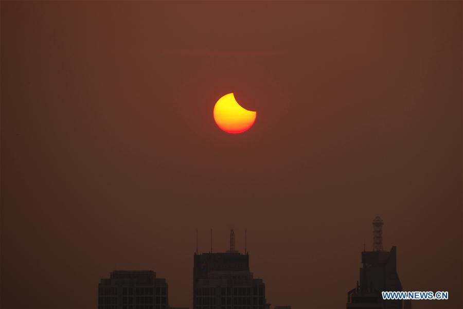 Photo taken on Aug. 11, 2018 shows the sun going through a partial solar eclipse in Jinan, capital of east China\'s Shandong Province. (Xinhua)