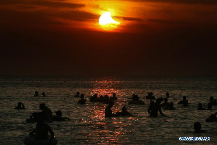 Photo taken on Aug. 11, 2018 shows the sun going through a partial solar eclipse in Yantai, east China\'s Shandong Province. (Xinhua/Tang Ke)