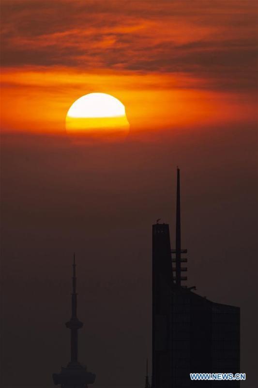 Photo taken on Aug. 11, 2018 shows the sun going through a partial solar eclipse in Nanjing, capital of east China\'s Jiangsu Province. (Xinhua/Su Yang)