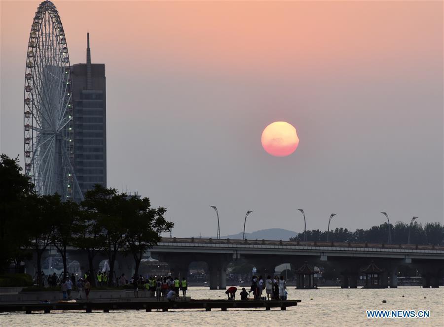 Photo taken on Aug. 11, 2018 shows the sun going through a partial solar eclipse in Wuxi City, east China\'s Jiangsu Province. (Xinhua/Huan Yueliang)