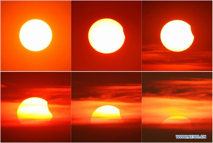 Combination photo taken on Aug. 11, 2018 shows the process of a partial solar eclipse in Changzhou City, east China\'s Jiangsu Province. (Xinhua/Chen Wei)