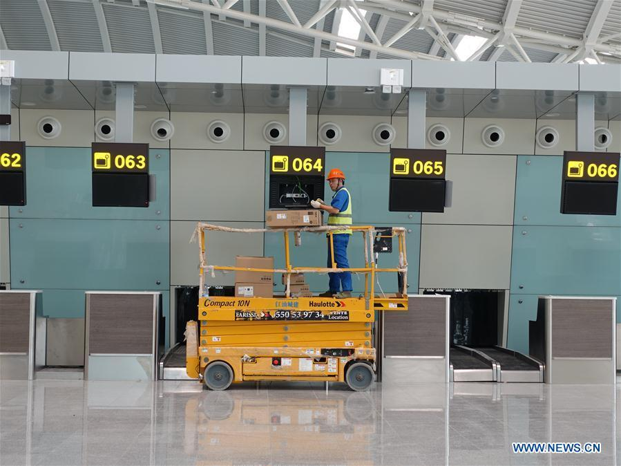 Photo taken on Aug. 10, 2018 shows a Chinese worker installing equipment at the passenger departure hall of the new Algiers Airport in Algeria. The construction of new Algiers Airport by China State Construction Engineering Corporation (CSCEC) will be completed soon. (Xinhua)