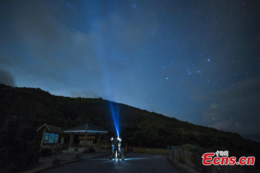 Visitors watch the Perseid meteor shower near the High Island Reservoir, where there's little light pollution, in Hong Kong, August 13, 2018. (Photo: China News Service/ Sheung Man Mak)