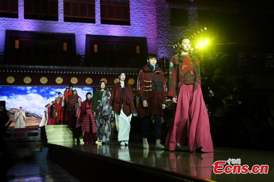 Models present outfits during a fashion show in Lhasa, Tibet Autonomous Region, Aug. 12, 2018. Models presented 84 designs including 26 traditional Tibetan costumes in the fashion show organized by Tibet Vocational Technical College and the Beijing Institute of Fashion Technology. (Photo/Xinhua)