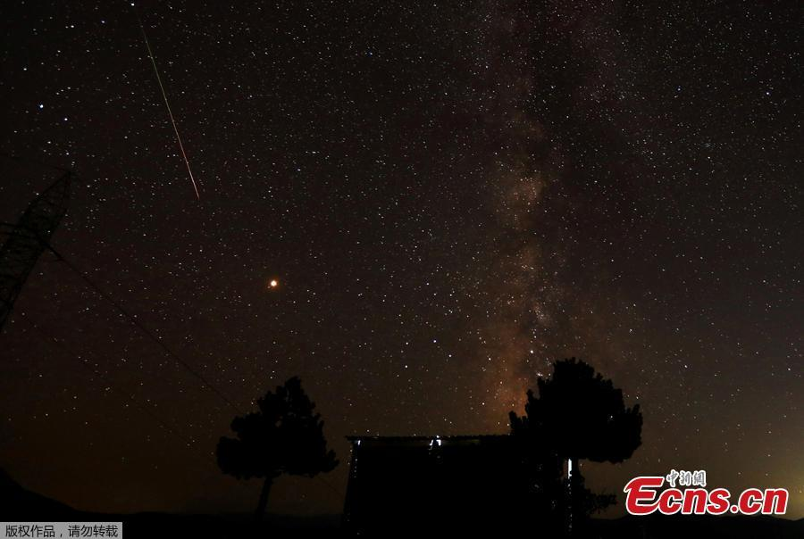 A meteor streaks over the skies over the milky way during the peak of Perseid meteor shower in Kozjak, Macedonia August 13, 2018. (Photo/Agencies)