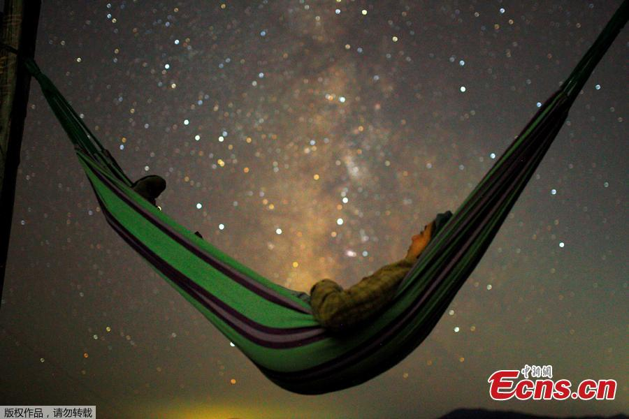 A girl lies in hammock as she looks at the milky way during the peak of Perseid meteor shower in Kozjak, Macedonia August 13, 2018. The so-called Perseids meteor shower returns to the skies every August and are best viewed in the northern hemisphere in isolated areas where there is little light pollution. (Photo/Agencies)