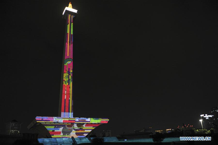 A video mapping work is projected on the facade of the National Monument also known as Monas to welcome the Asian Games in Jakarta, Indonesia, Aug. 13, 2018. (Xinhua/Zulkarnain)