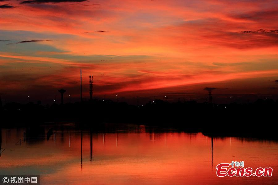 Crimson clouds at sunset hang over the sky in Shaoxing City, Zhejiang Province, Aug. 14, 2018, after the typhoon Yagi. (Photo/VCG)