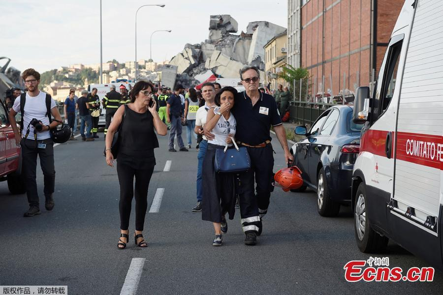 A woman cries being embraced by a fire fighter as she leaves the site of the collapsed Morandi Bridge in the port city of Genoa, Italy August 14, 2018. The bridge connects the highway A10 to the western part of the city, near a populous neighborhood called Sampierdarena. At least 26 people were killed in the accident. (Photo/Agencies)