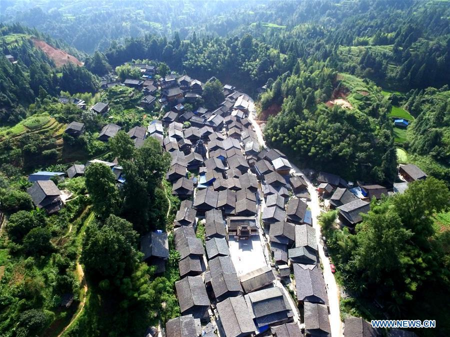 Photo taken on Aug. 14, 2018 shows the Zaidang village of Dong ethnic group, Qiandongnan of southwest China\'s Guizhou Province. Zaidang, a village of Dong ethnic group, has encouraged its villagers to make use of idle resources to upgrade local infrastructure, in an aim to develop tourism industry and shake off poverty. (Xinhua/Wang Bingzhen)
