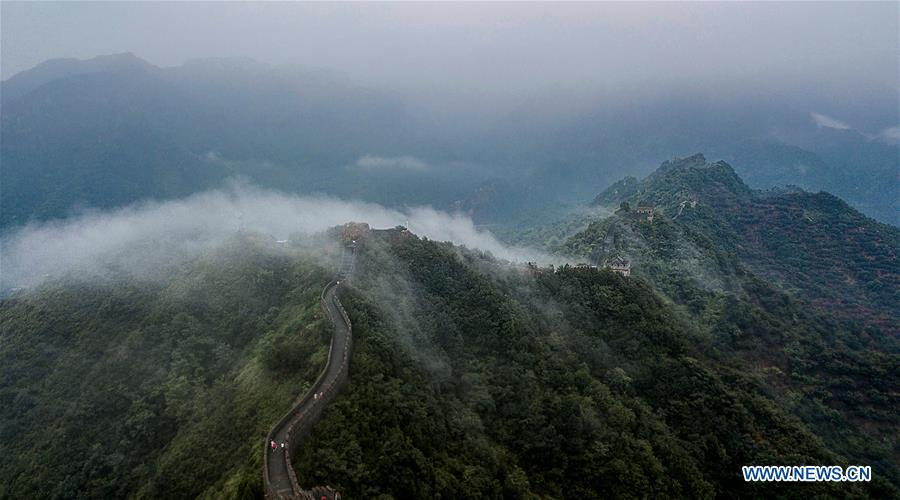 Photo taken on Aug. 13, 2018 shows cloud and fog after a rainfall at Huangyaguan section of the Great Wall in the Jizhou District of Tianjin, north China. (Xinhua/Wang Guangshan)