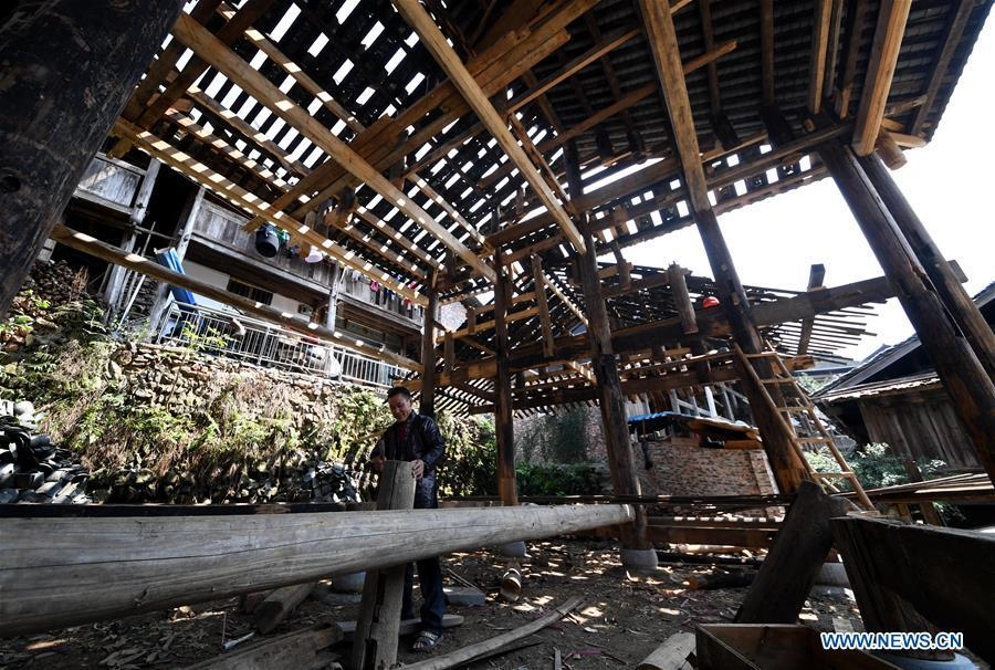 A villager does carpenter work in an old opera stage in reform in Zaidang, Qiandongnan of southwest China\'s Guizhou Province, Aug. 14, 2018. Zaidang, a village of Dong ethnic group, has encouraged its villagers to make use of idle resources to upgrade local infrastructure, in an aim to develop tourism industry and shake off poverty. (Xinhua/Wang Bingzhen)