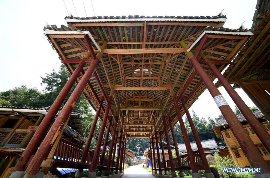 Photo taken on Aug. 14, 2018 shows a wooden bridge in Zaidang, Qiandongnan of southwest China\'s Guizhou Province. Zaidang, a village of Dong ethnic group, has encouraged its villagers to make use of idle resources to upgrade local infrastructure, in an aim to develop tourism industry and shake off poverty. (Xinhua/Wang Bingzhen)