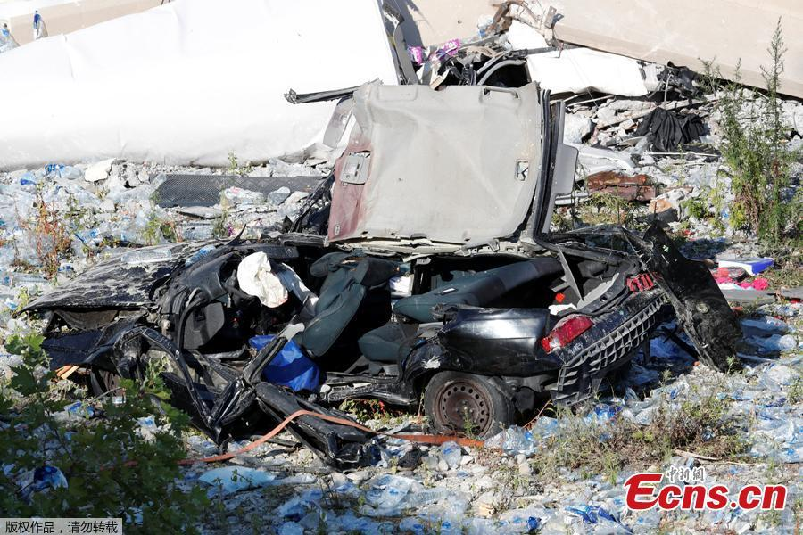 A crushed car is seen at the collapsed Morandi Bridge site in the port city of Genoa, Italy August 14, 2018. The bridge connects the highway A10 to the western part of the city, near a populous neighborhood called Sampierdarena. At least 26 people were killed in the accident. (Photo/Agencies)