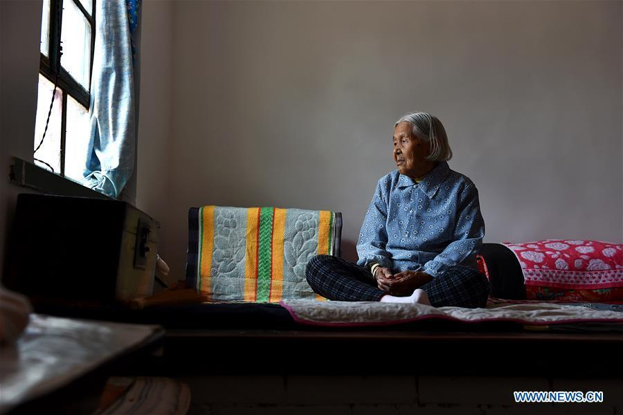 Li Ailian sits on the bed in Shaoqu Village of Wuxiang County, north China\'s Shanxi Province, Aug. 3, 2016. Li died on Jan. 23, 2018 at the age of 90. In the summer of 1945, Li was abducted and abused regularly by Japanese invaders for over 50 days. Women forced into sexual slavery by the Imperial Japanese Army before and during World War II were called \