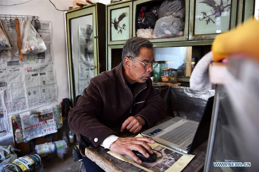 Zhang Shuangbing looks at the screen of his laptop on March 2, 2016. For more than 10 years Zhang Shuangbing, a retired Chinese village teacher, painstakingly recorded the heart-wrenching experiences of 129 Chinese women who were forced into sexual slavery by Japanese invaders during World War II. Women forced into sexual slavery by the Imperial Japanese Army before and during World War II were called \