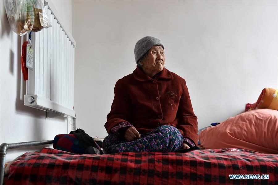 Zhao Lanying sits on the bed on March 9, 2016. Zhao died at the age of 93 in Xinyi Village of Wuxiang County, north China\'s Shanxi Province, April 7, 2016. In June of 1941, Zhao and two sisters were captured by Japanese invaders. About two months later, her family took her home. Zhao spent three month to recover from physical injury but remained emotionally-wounded for her lifetime. Women forced into sexual slavery by the Imperial Japanese Army before and during World War II were called \