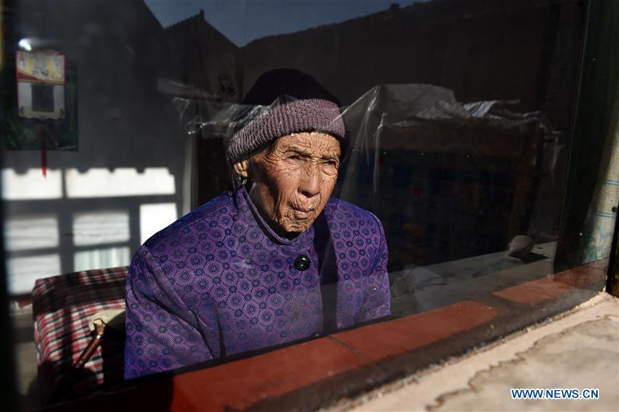 Ren Lan\'e is seen at home at Gucheng Village of Wuxiang County, north China\'s Shanxi Province, March 10, 2016. Ren died on July 1, 2016 at the age of 85. In August of 1944, Ren was raped by Japanese invaders at her home and taken to a gun turret. About one month later, she was rescued by her brother. Women forced into sexual slavery by the Imperial Japanese Army before and during World War II were called \
