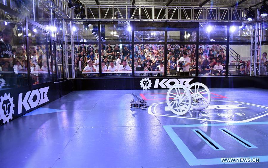 Photo taken on Aug. 15, 2018 shows a robot wrestle contest at World Robot Conference 2018 in Beijing, capital of China. Kicking off on Wednesday, the conference attracted more than 160 domestic and international corporations exhibiting their cutting-edge products in the robotics industry. (Xinhua/Li Xin)