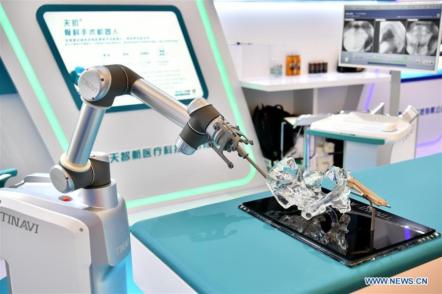 Photo taken on Aug. 15, 2018 shows a robot performing orthopedic surgery at World Robot Conference 2018 in Beijing, capital of China. Kicking off on Wednesday, the conference attracted more than 160 domestic and international corporations exhibiting their cutting-edge products in the robotics industry. (Xinhua/Li Xin)