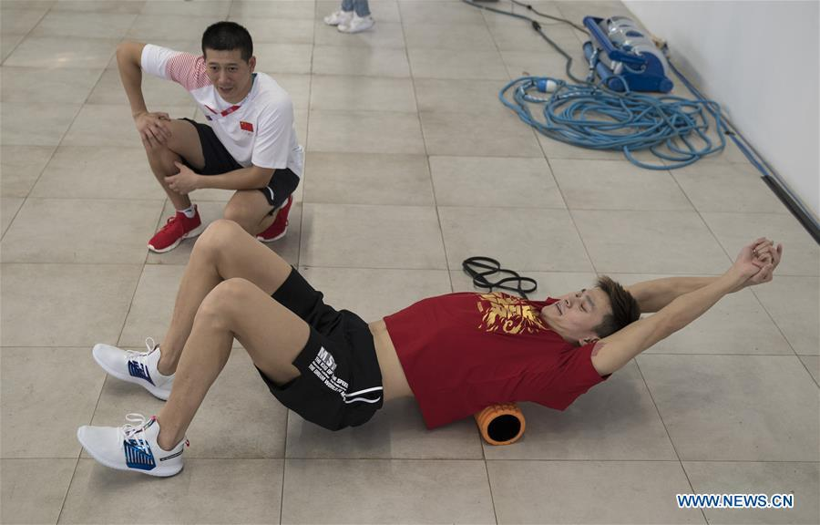 Chinese swimming athlete Sun Yang (Bottom) takes warm-up exercises for the upcoming Asian Games in Jakarta, Indonesia, Aug. 15, 2018. (Xinhua/Fei Maohua)
