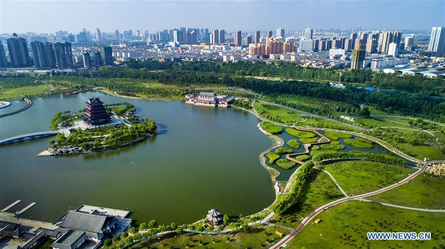 Aerial photo taken on Aug. 2, 2018 shows a view of the Yuxihe Park in the Yuyang District of Yulin City, northwest China\'s Shaanxi Province. The administrative region of Yulin City is located to the south of the Maowusu Desert. Environment protection measures have curbed the expansion of the desert and then witnessed the retreat of the desert as a result of the increase in planted forests and grasslands after reducing and stopping farming and animal husbandry. (Xinhua/Tao Ming)