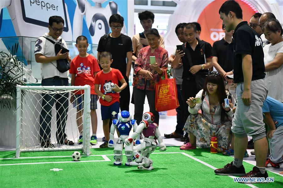 Photo taken on Aug. 15, 2018 shows two robots playing football at World Robot Conference 2018 in Beijing, capital of China. Kicking off on Wednesday, the conference attracted more than 160 domestic and international corporations exhibiting their cutting-edge products in the robotics industry. (Xinhua/Li Xin)