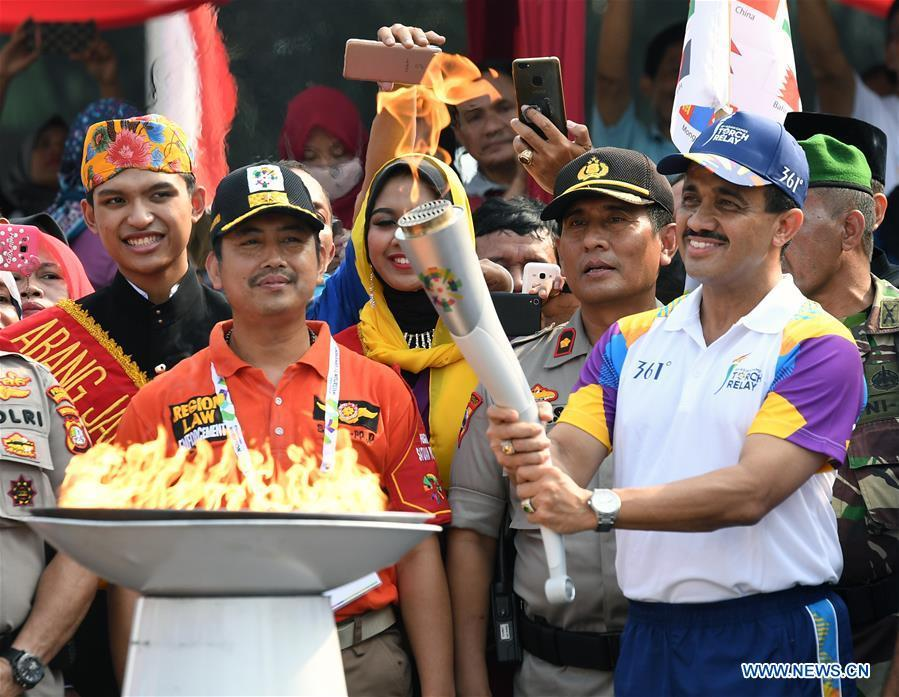 Mayor of East Jakarta M. Anwar (R Front) participates in the Torch Relay in Jakarta, Indonesia, Aug. 15, 2018. The 2018 Asian Games will kick off here on Aug. 18. (Xinhua/Li He)