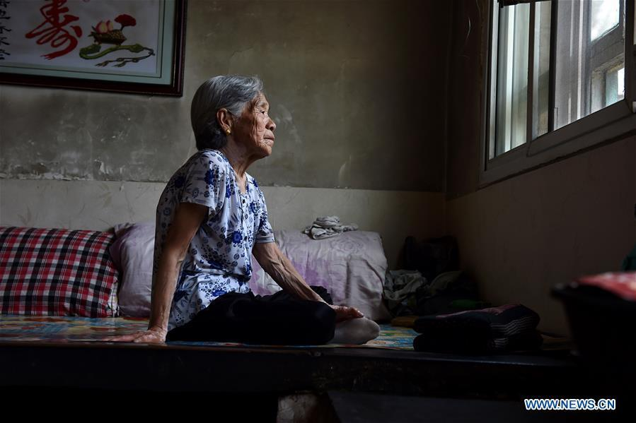 Liu Fenghai sits on the bed on Aug. 3, 2016. Liu died at the age of 90 in Nanyuan Village of Qinxian County, north China\'s Shanxi Province, Jan. 20, 2017. In the spring of 1943, Liu Fenghai and villager Liu Yuegui were captured and being raped by Japanese invaders. They were thrown into a valley several days later. Liu Fenghai never received the apology she longed for in her lifetime. Women forced into sexual slavery by the Imperial Japanese Army before and during World War II were called \