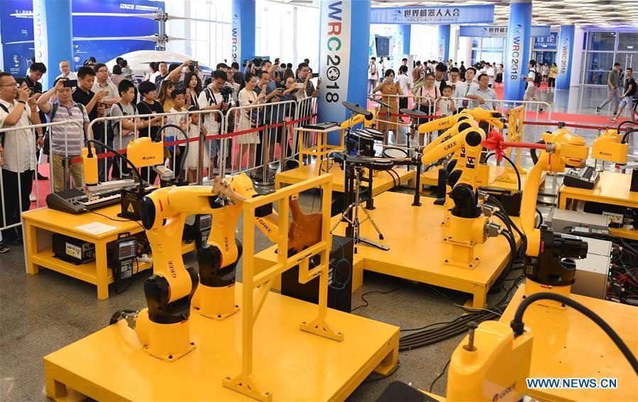 Visitors watch the performance of a robot orchestra at World Robot Conference 2018 in Beijing, capital of China, Aug. 15, 2018. Kicking off on Wednesday, the Conference attracted contestants from 16 countries and regions to participate in the contest section. (Xinhua/Zhang Chenlin)