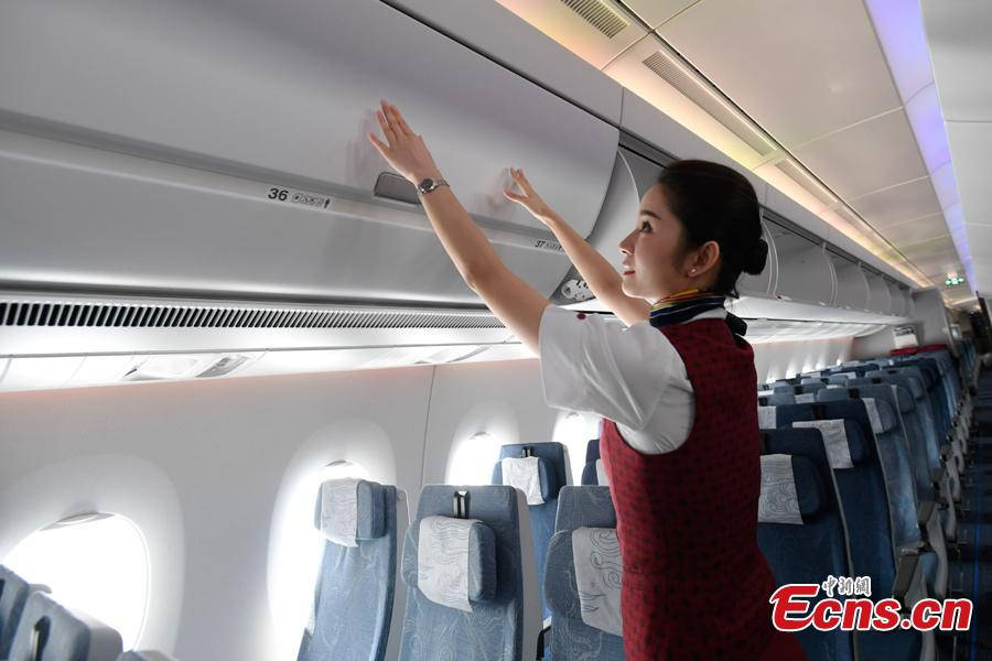 A stewardess makes security check in Air China's first A350-900 aircraft before it flies on the Beijing-Chengdu route, Aug. 15, 2018. Air China has configured the widebody aircraft with three classes, offering a total of 312 seats. The business class cabin has 32 seats laid out in a 1-2-1 reverse herringbone pattern. The premium economy cabin has 24 seats and the economy cabin offers 256 seats. (Photo: China News Service/An Yuan)
