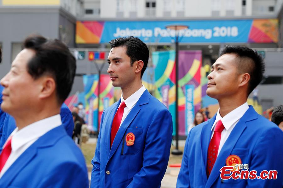 A flag-raising ceremony is held for Chinese athletes to the 18th Asian Games in Jakarta, Aug. 16, 2018. (Photo: China News Service/Liu Guanguan)