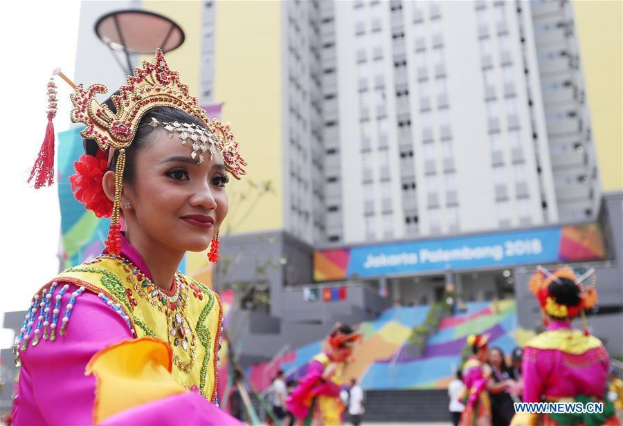 Etiquette team members in Indonesian folk costume welcome athletes at the Asian Games Village ahead of the 18th Asian Games in Jakarta, Indonesia, on Aug. 16, 2018. (Xinhua/Wang Lili)