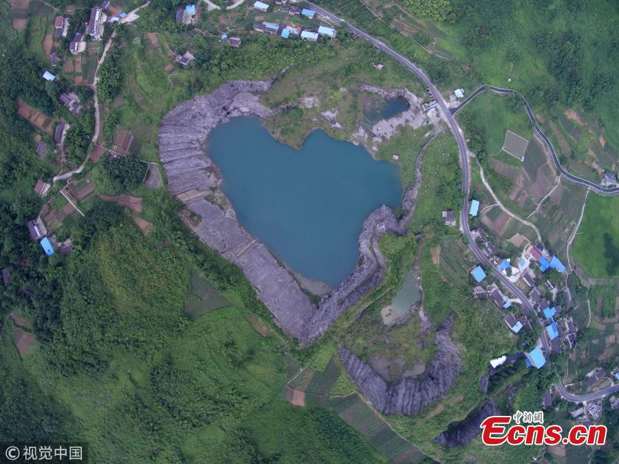 <?php echo strip_tags(addslashes(File photo shows a heart-shaped lake.(Photo/VCG))) ?>