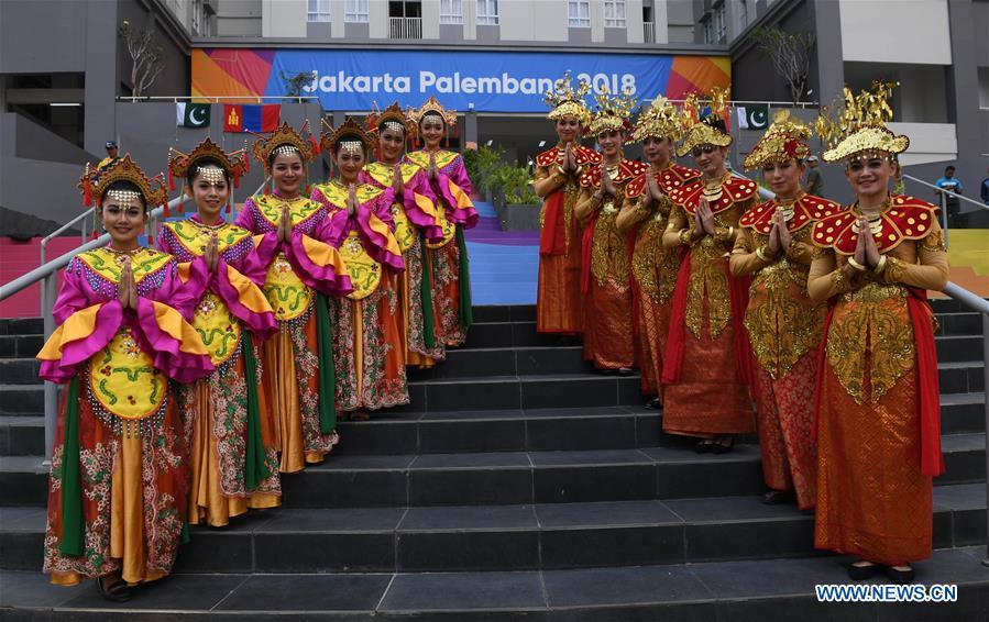 Etiquette team members in Indonesian folk costume welcome athletes at the Asian Games Village ahead of the 18th Asian Games in Jakarta, Indonesia, on Aug. 16, 2018. (Xinhua/Wang Yuguo)