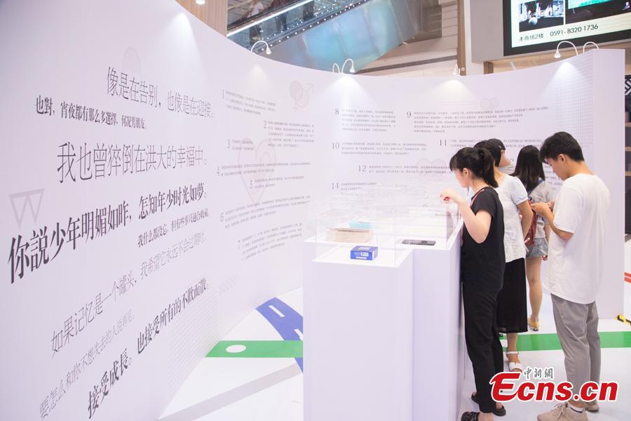 An exhibition devoted to the wreckage of lost love is held in Art Mall in Fuzhou City, East China's Fujian Province, Aug. 16, 2018. The exhibition collected the detritus of relations that had turned sour - unwanted love letters, photos, and gifts as well as the stories of brokenhearted people. The curator of the exhibition, named 'Healing', said the show aimed at encouraging people to reconcile with their pasts. (Photo: China News Service/Li Nanxuan)