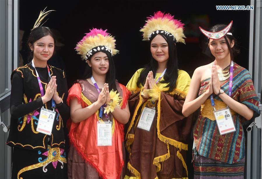 Volunteers in Indonesian folk costumes welcome guests at the Asian Games Village ahead of the 18th Asian Games in Jakarta, Indonesia, on Aug. 17, 2018. August 18 will witness the opening ceremony of the 18th Asian Games in Jakarta, Indonesia. (Xinhua/Huang Zongzhi)