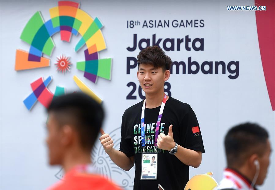Chinese badminton athlete Liu Yuchen poses for pictures at the Asian Games Village ahead of the 18th Asian Games in Jakarta, Indonesia, on Aug. 17, 2018. August 18 will witness the opening ceremony of the 18th Asian Games in Jakarta, Indonesia. (Xinhua/Huang Zongzhi)