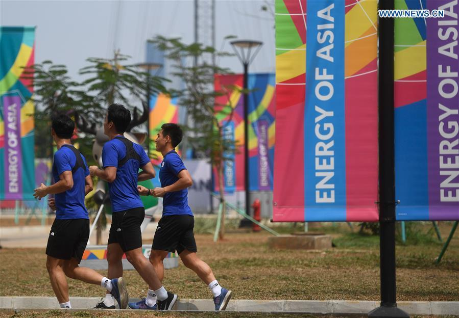 Athletes jog at the Asian Games Village ahead of the 18th Asian Games in Jakarta, Indonesia, on Aug. 17, 2018. August 18 will witness the opening ceremony of the 18th Asian Games in Jakarta, Indonesia. (Xinhua/Huang Zongzhi)
