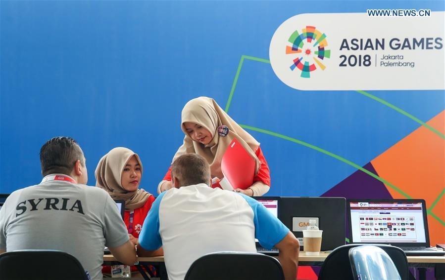 Volunteers provide service for athletes at the Asian Games Village ahead of the 18th Asian Games in Jakarta, Indonesia, on Aug. 17, 2018. August 18 will witness the opening ceremony of the 18th Asian Games in Jakarta, Indonesia. (Xinhua/Ding Ting)