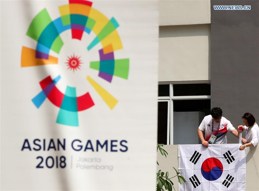 Members of South Korean delegation hang up their national flag at the Asian Games Village ahead of the 18th Asian Games in Jakarta, Indonesia, on Aug. 17, 2018. August 18 will witness the opening ceremony of the 18th Asian Games in Jakarta, Indonesia. (Xinhua/Ding Ting)