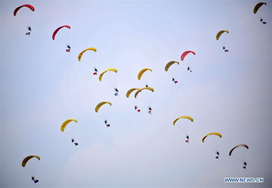 Photo taken on Aug. 18, 2018 shows a paramotor performance during the opening ceremony of the 7th Faku Flight Conference in Shenyang, capital of northeast China\'s Liaoning Province. The flight conference kicked off here on Saturday. (Xinhua/Yao Jianfeng)