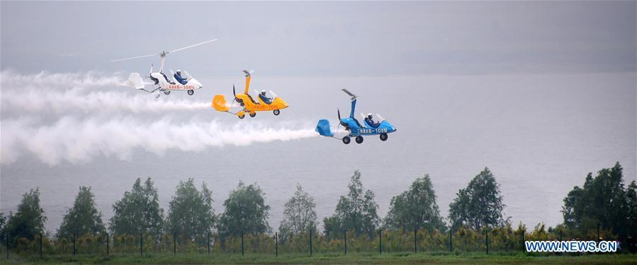 Photo taken on Aug. 18, 2018 shows an aerobatic flight performance during the opening ceremony of the 7th Faku Flight Conference in Shenyang, capital of northeast China\'s Liaoning Province. The flight conference kicked off here on Saturday. (Xinhua/Yao Jianfeng)