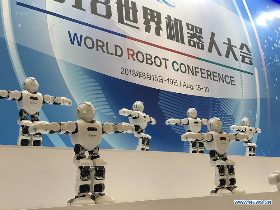 Robots are dancing at the 2018 World Robot Conference in Beijing, Aug. 17, 2018. The conference attracts a total of 166 domestic and international enterprises exhibiting their cutting edge technologies and more than 500 items are displayed at the scene. (Xinhuanet/Liang Yurou)