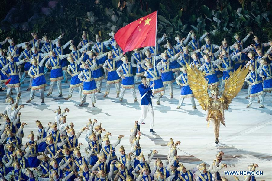Delegation of China enters the Gelora Bung Karno (GBK) Main Stadium at the opening ceremony of the 18th Asian Games in Jakarta, Indonesia, Aug. 18, 2018.(Xinhua/Cheong Kam Ka)