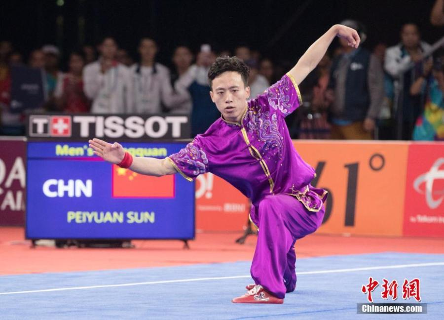 Sun Peiyuan of China competes during the Men\'s Changquan final at the 18th Asian Games in Jakarta, Indonesia Aug. 19, 2018. (Photo/China News Service)