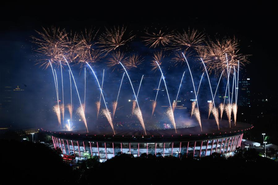 Fireworks explode over the Gelora Bung Karno (GBK) Main Stadium at the opening ceremony of the 18th Asian Games in Jakarta, Indonesia, Aug. 18, 2018.(Xinhua/Li Xiang)