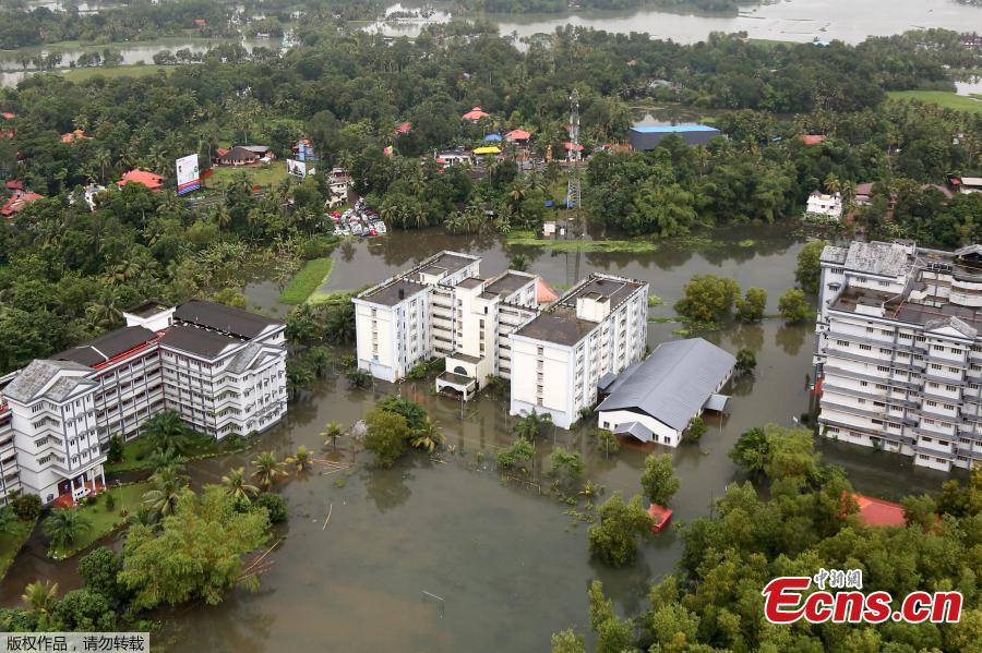 An aerial view shows partially submerged buildings at a flooded area in the southern state of Kerala, India, August 19, 2018. Incessant downpours since Aug. 8 have caused the worst floods in a century in the southwestern state, and close to 200 people have perished in the rising waters and landslides. (Photo/Agencies)