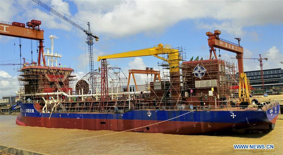Photo taken on Aug. 19, 2018 shows the dredging vessel in Qidong, east China\'s Jiangsu Province. Two dredging vessels lauched recently. The 108.5-meter-long vessel can dig as deep as 30 meters under the sea floor and store 6,500 cubic meters of silt. (Xinhua/Xu Congjun)